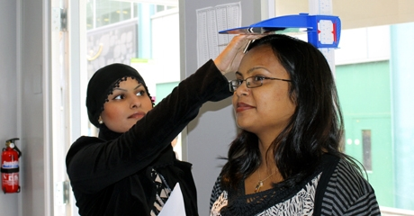 Health Trainers measuring a client's height